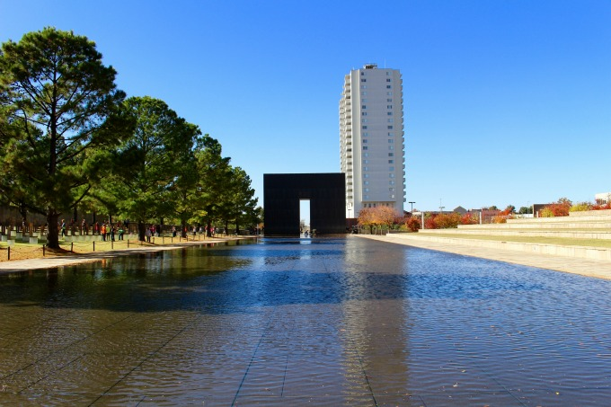 "One of two Gates of Time that frame the reflecting pool. The Gates of Time, are stamped with two key times: 9:01, representing the last moment of peace, and 9:03 the moment recovery began. The reflecting pool allows visitors to see ""reflections of those forever changed."""