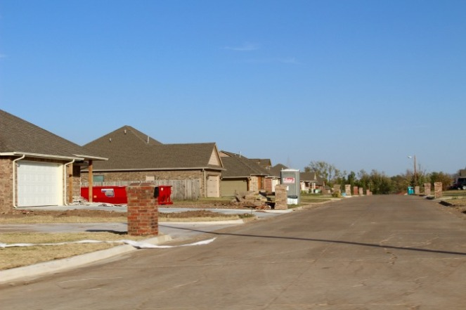 One of many neighborhoods undergoing new construction where the path of the 2013 tornado left thousands of homes flattened.