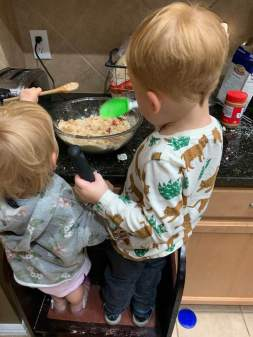 Both helping to make a batch of chickpea salad for lunches.
